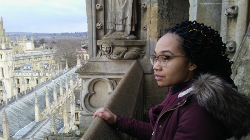 Female student overloooking Oxford University Campus from a tower.
